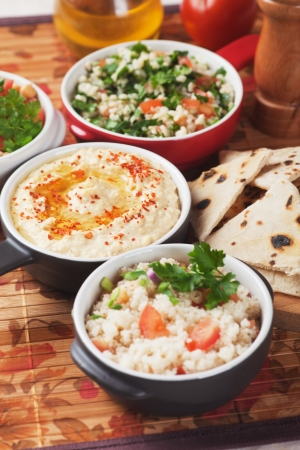 tabbouleh: Hummus, couscous and tabbouleh, traditional middle-east meals Stock Photo