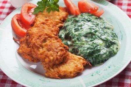jewish cuisine: Latke, potato pancakes with creamy spinach mash