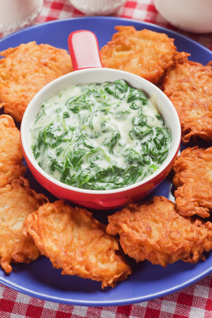 Thick and creamy spinach soup with potato pancakes photo