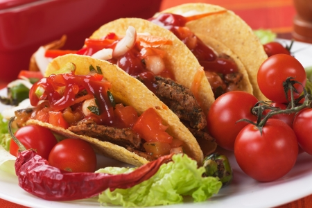 chicken meat: Taco shells filled with grilled chicken meat and fresh vegetable salad