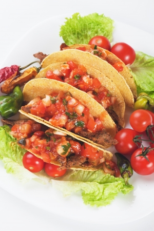 ground beef: Taco shells filled with ground beef and fresh vegetable