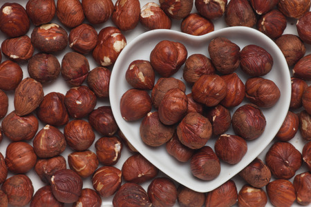 Hazelnuts, healthy food ingredient in heart shaped tray Stock Photo - 27044397