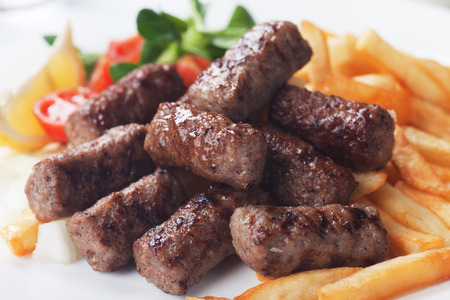 turkish kebab: Grilled kebab, turkish style barbecued meat with fried potato Stock Photo