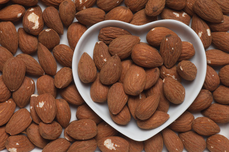 Almond nuts, healthy food ingredient in heart shape tray Stock Photo - 27045133