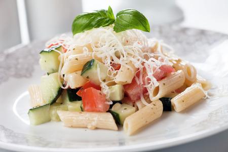 pasta salad: Italian macaroni pasta salad with cheese, tomato and cucumber