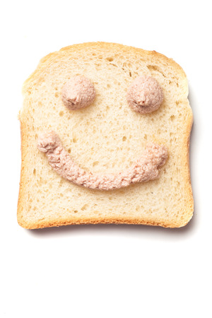 pate: Happy smiley pâté spread, slice of bread isolated on white