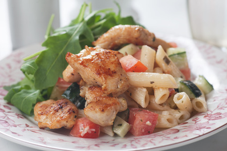 pasta salad: Grilled chicken meat with pasta and vegetables, healthy and rich salad