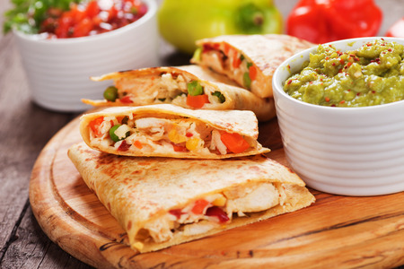 prepared food: Mexican quesadillas with chicken meat, cheese and vegetables