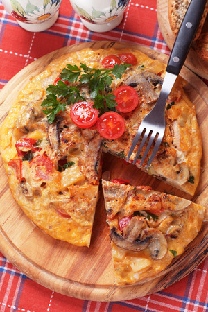omelet: Tortilla, spanish omelet with mushrooms, potato and vegetables