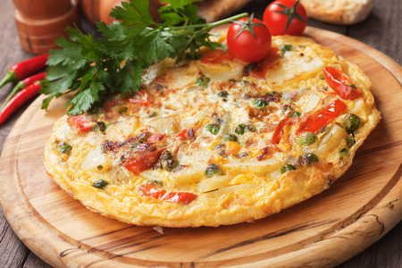 omelet: Tortilla, spanish omelet with fried potato and vegetables Stock Photo