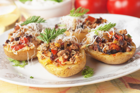 baked meat: Oven roasted potatoes stuffed with ground beef and vegetables
