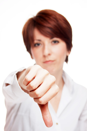 disapprove: Business woman showing thumb down sign, isolated on white background