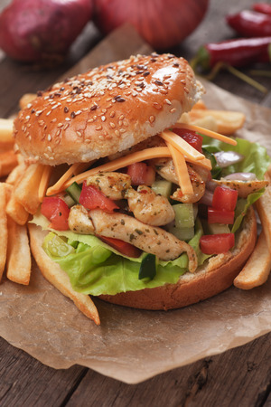 chicken salad: Chicken salad burger with fresh vegetables and french fries