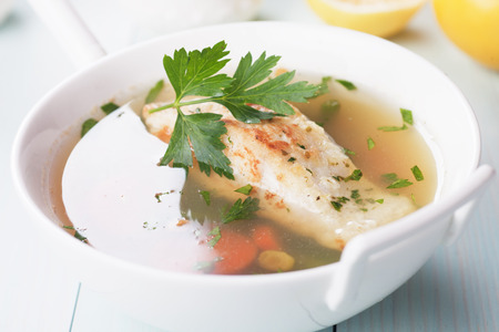 seafood soup: Seafood soup with cod fish steak and vegetables Stock Photo