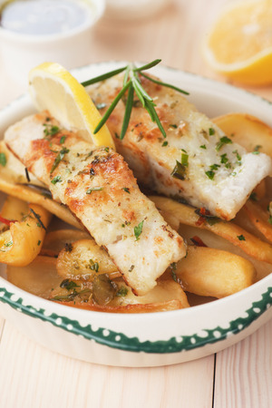 potato cod: Grilled cod fish with fried potato and lemon