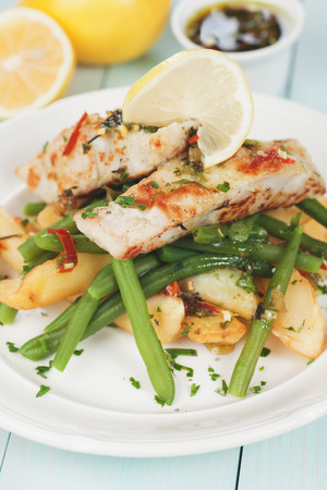 potato cod: Grilled cod fish with fried potato and green bean Stock Photo