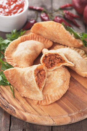 meat pie: Fried empanada stuffed with ground beef, classic latin american appetizer Stock Photo