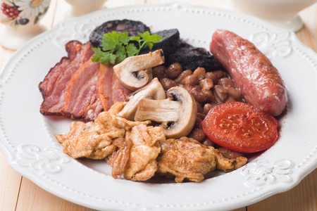 english breakfast: Full english breakfast with scrambled egg, bacon, mushrooms, sausage and black pudding