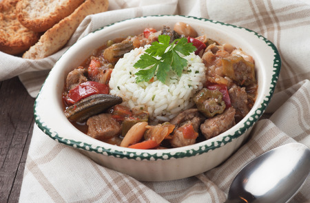 cooked rice: Pork and okra gumbo, cajun style stew served with cooked rice