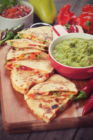 mexican food: Mexican quesadillas with cheese, vegetable and guacamole dip