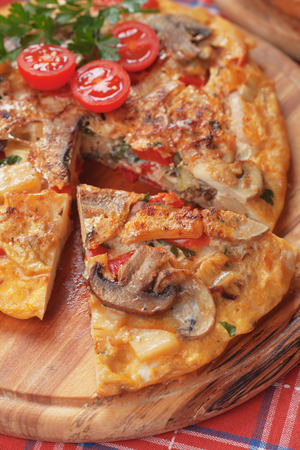 omelet: Spanish tortilla omelet with eggs, potato, mushrooms and vegetable Stock Photo