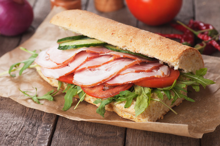 sandwich bread: Submarine sandwich with smoked ham, tomato and rocket salad