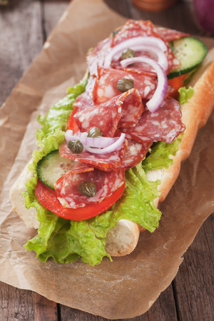 italian sausage: Submarine sandwich with italian sausage, tomato and lettuce salad Stock Photo