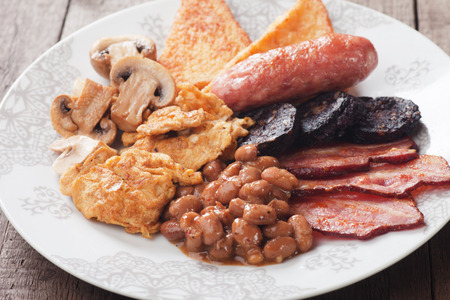 english breakfast: Full english breakfast with eggs, bacon, black pudding, sausage and mushrooms