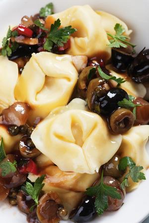 pasta salad: Italian tortellini pasta salad with parsley and green olives