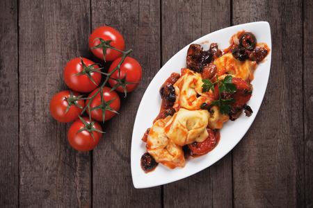 tortellini: Italian tortellini pasta in tomato and olive sauce