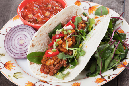 ground beef: Mexican tortilla wrap, burrito with chili, beans and ground beef
