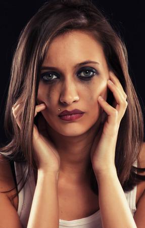 crying girl: Emotional portrait of crying girl, studio shot over black background