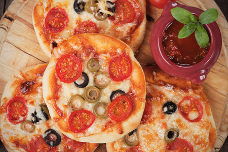 margherita: Mini margherita pizzas with cheese, olive and tomato