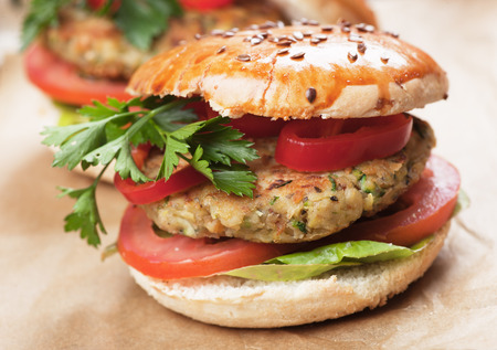 american food: Vegan burger with tomato and lettuce, healthy vegetarian version of classic american fast food