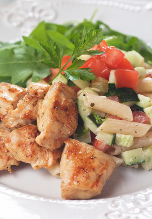pasta salad: Chicken and pasta salad with tomato and cucumber Stock Photo