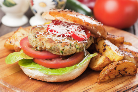 vegetarian food: Vegan burger with tomato and lettuce, healthy vegetarian version of classic american fast food