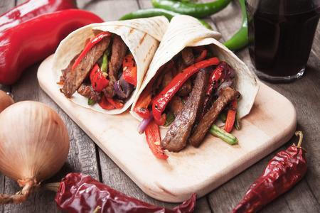fajita: Fajitas, mexican beef with grilled vegetable in tortilla wraps Stock Photo