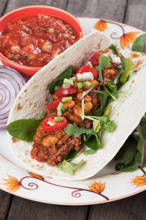 tortilla wrap: Mexican tortilla wrap, burrito with chili, beans and ground beef