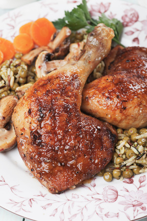 chicken rice: Roasted chicken legs with rice and green peas, classic of traditional cuisine Stock Photo