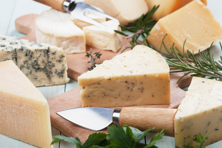 healthy snack: Assorted cheese on wooden table, rich and healthy snack or breakfast Stock Photo