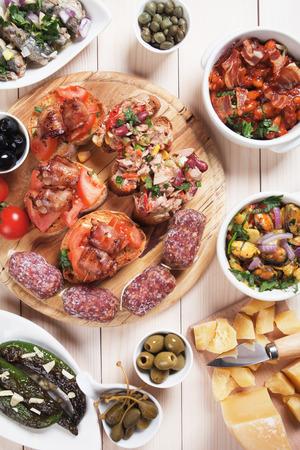 eating meat: Tapas or antipasto food, mediterranean cold buffet