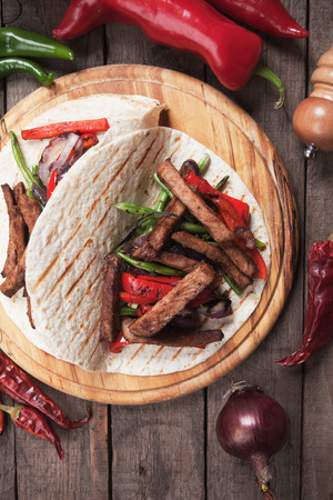 fajita: Fajitas, mexican beef stripes with grilled vegetable in tortilla wraps