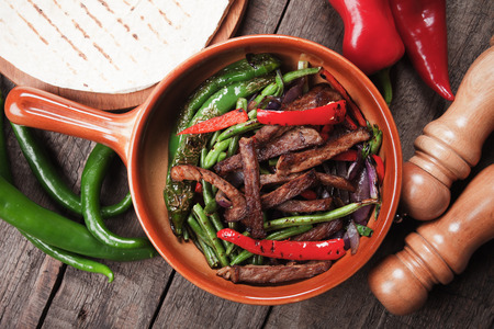 fajita: Fajitas, mexican beef with grilled vegetable and tortillas Stock Photo
