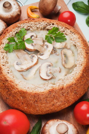 button mushroom: Creamy portabello mushroom soup served in wholegrain bread Stock Photo