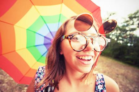 rainbow umbrella: Vintage portrait of smiling young girl wih rainbow umbrella Stock Photo