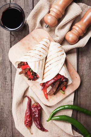 tortilla wrap: Mexican fajitas, spicy beef and vegetable in tortilla wrap Stock Photo