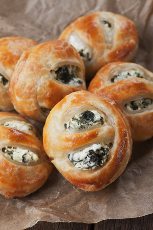 party pastries: Puff pastry filled with spinach and cheese Stock Photo