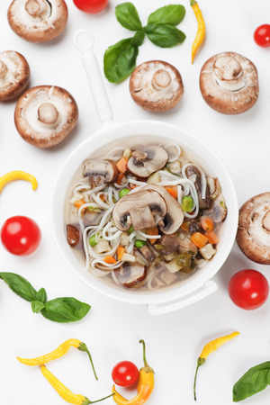 button mushroom: Clear portabello mushroom soup with noodle and vegetable Stock Photo