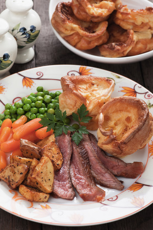 british cuisine: Traditional british sunday roast with yorkshire pudding, roasted potato and vegetables