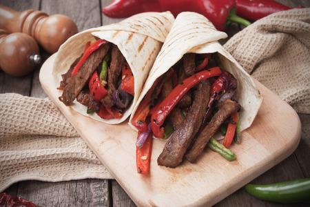fajita: Fajitas, mexican beef stripes with vegetables in tortilla wrap